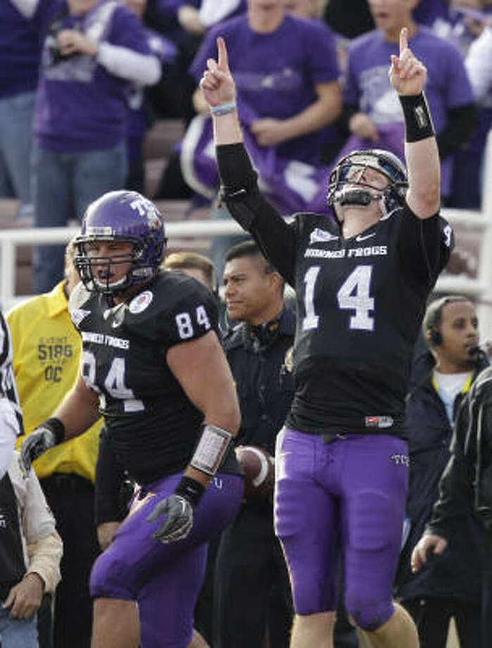 TCU quarterback Andy Dalton (14) celebrates a touchdown during the first half of the Rose Bowl on Saturday. Photo: Marcio Sanchez, AP
