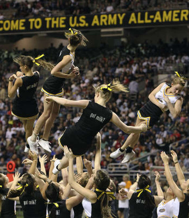 Cheerleaders perform Saturday at the 2011 U.S. Army All-American Bowl at the Alamodome. The bowl's future in San Antonio is up in the air until a contract with Alamodome is signed. Photo: KIN MAN HUI, SAN ANTONIO EXPRESS-NEWS