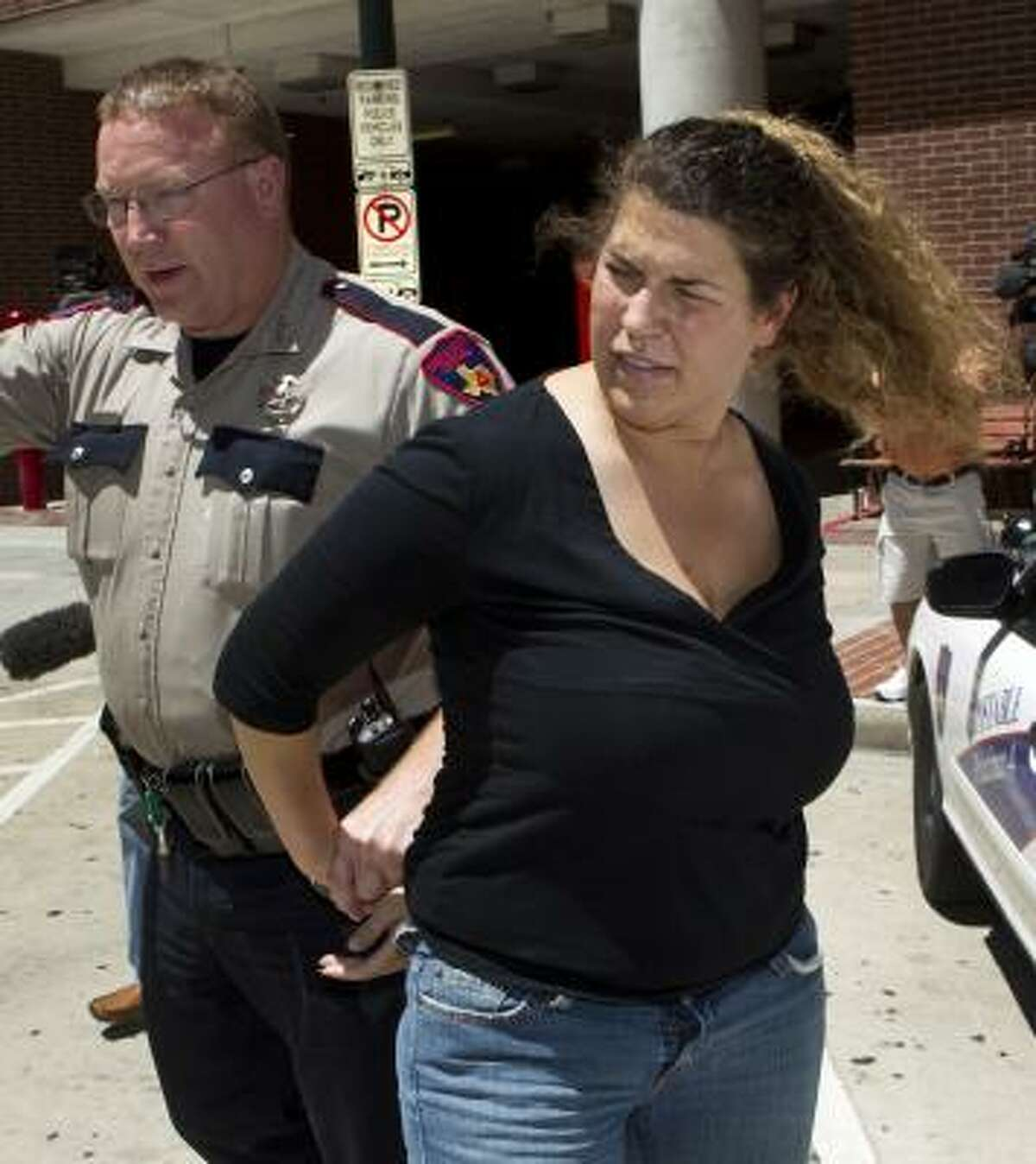 Intoxicated manslaughter suspect Julie Little, 38, is taken into custody Thursday, May 26, 2011, in Houston.