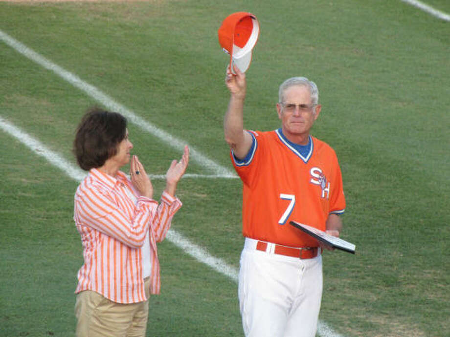 Sam Houston State baseball coach Mark Johnson acknowledges Bearkats fans at a recent ceremony commemorating his career as his wife, Linda, joins in the tribute. Photo: COURTESY OF SAM HOUSTON STATE UNIVERSITY