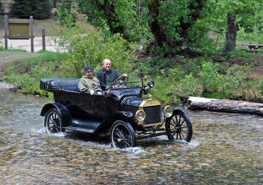 Crossing a stream is no problem for Paul Whitefield and one of his sons thanks to the Model T's high clearance. Photo: DAVID WOODWORTH, LOS ANGELES TIMES