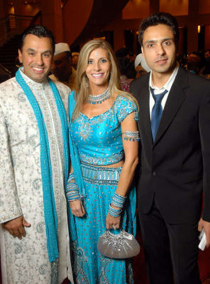 Dr. Devinder Bhatia and Gina Bhatia, gala chairs, were joined by Indian television idol Mohammed Iqbal Khan, right, at the Indian Film Festival Celebrity Gala held at the InterContinental Houston. Photo: Dave Rossman