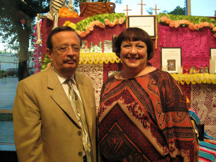 Carlos Ignacio González Magallón, consul general of Mexico, and Christine Jelson West, Lawndale Art Center executive director, help celebrate Lawndale's Día de los Muertos event. Photo: Douglas Britt :