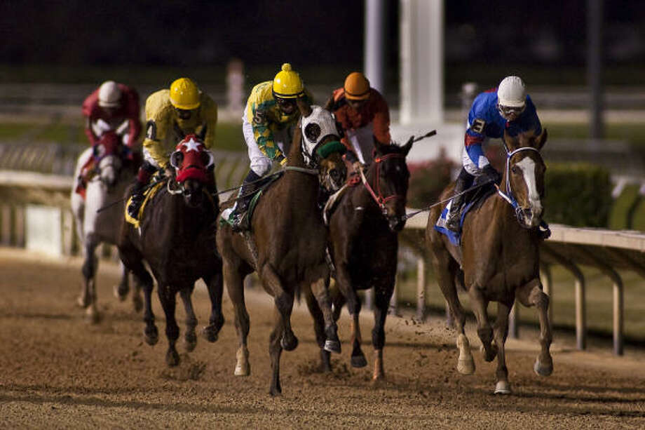 Msdiamondcity, center, and jockey Carlos Marquez wins the Six Furlongs Maiden Claiming race during Friday's opening day at Sam Houston Race Park. Robielee, ridden by Jeremy Collier, took second, and Kelsi Purcell on Weekend Song took third in the evening's second race. Photo: Nathan Lindstrom, For The Chronicle