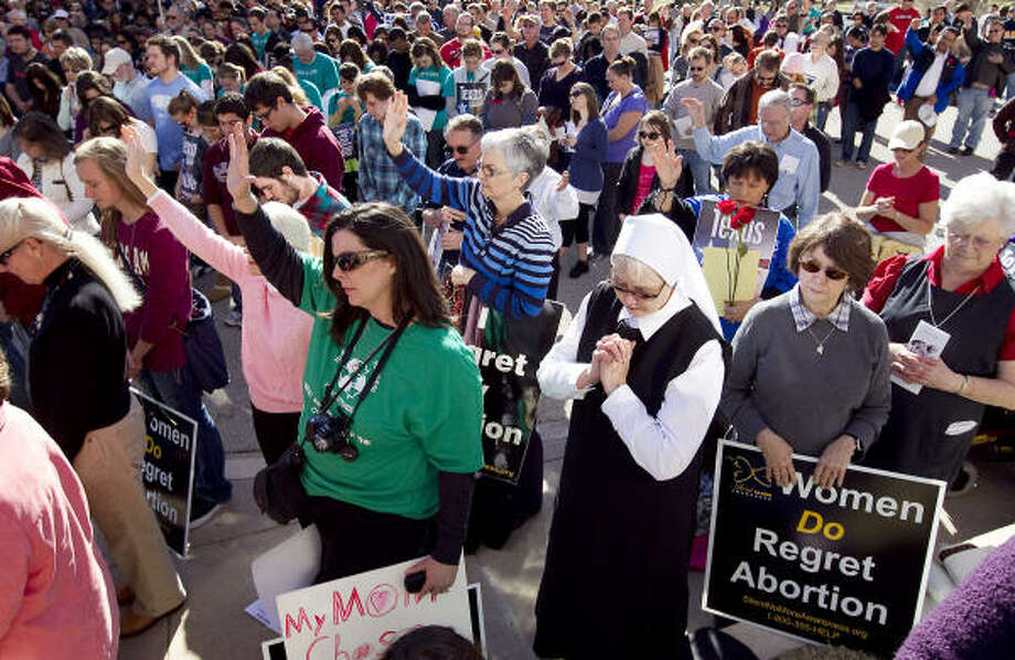 The Texas Rally for Life on Saturday ended on the south steps of the Capitol after a march through downtown. Gov. Rick Perry spoke at the event, held on the 38th anniversary of Roe v. Wade. Photo: Larry Kolvoord, Austin American-Statesman