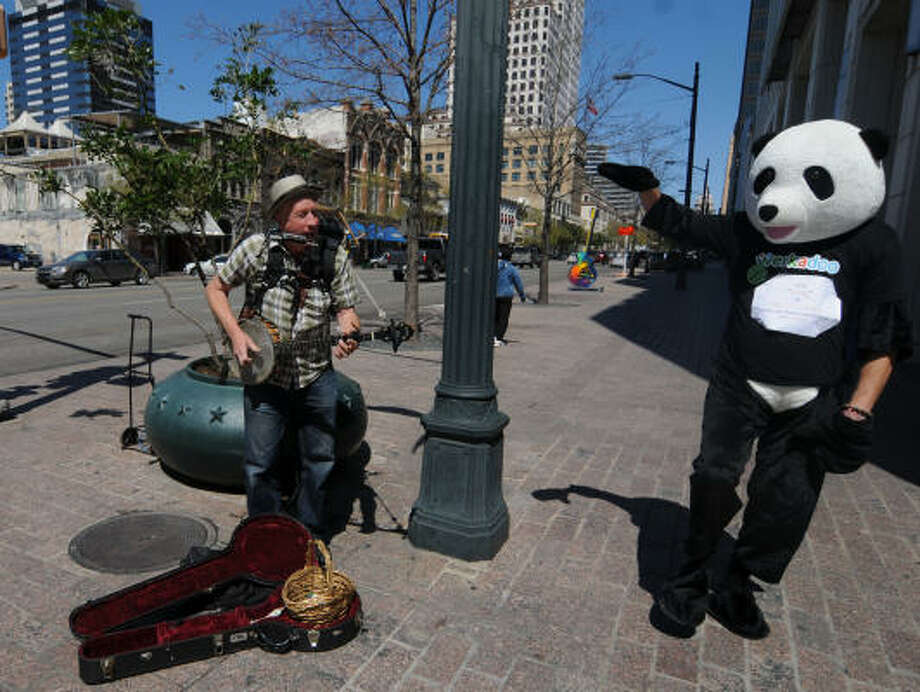 Teddy Boxberger dances to the music of MrJoJangles of Detroit on Friday along Congress Avenue during South by Southwest in Austin. The Web site Werkadoo hired Boxberger to draw attention to the matchmaking site for employers and freelancers during South by Southwest. company. Photo: Patrick Meredith:, For The Chronicle