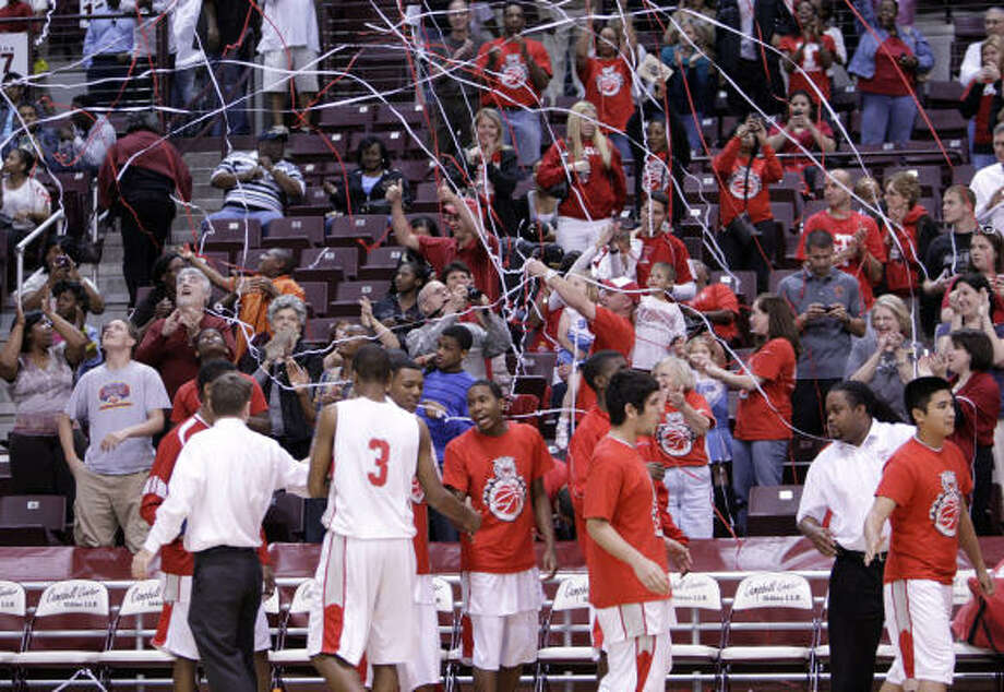Travis fans celebrate the win over Clear Springs during the Class 5A quarterfinals. Photo: Bob Levey, For The Chronicle
