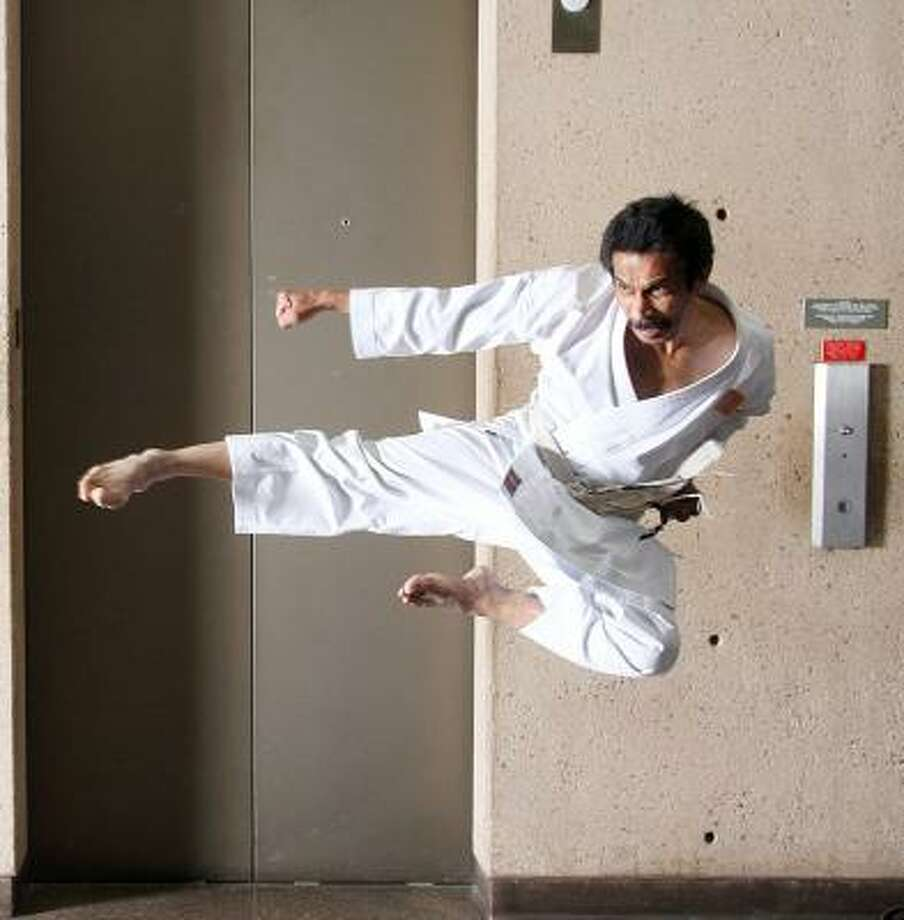 POWER HOUSE: Deddy Mansyur, 54, is a Japan-certified sixth-degree black belt in Shotokan karate. Photo: Pin Lim, For The Chronicle