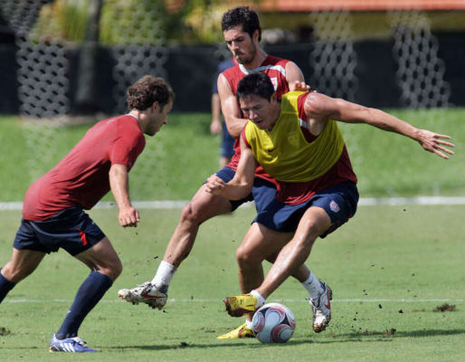Benny Feilhaber, back, chases Brian Ching during the U.S. team's practice before a World Cup qualifier in 2009. Photo: Jeffrey M. Boan, AP