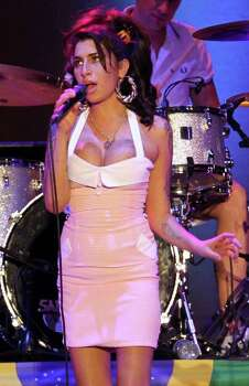 FILE- In this Jan. 8, 2011 file photo, British artist Amy Winehouse performs during her show in Florianopolis, Brazil. The singer was found dead Saturday, July 23, 2011, by ambulance crews who were called to her home in north London's Camden area. She was 27. (AP Photo/Nabor Goulart, File) Photo: Nabor Goulart