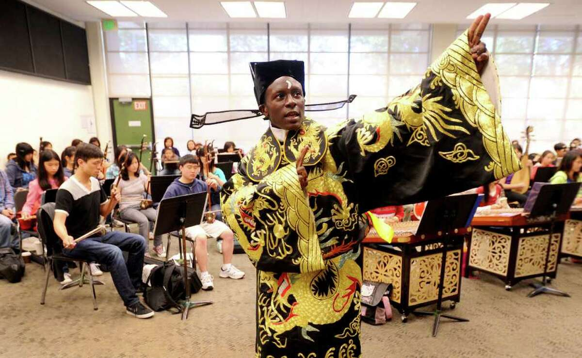 In this photo taken Saturday, June 11, 2011, Tyler Thompson rehearses with the Great Wall Youth Orchestra in Oakland, Calif. The 15-year-old Oakland native, who sings traditional Chinese opera in Mandarin, plans to perform in China this summer. Thompson is an unlikely star in the world of Chinese opera. The African American teenager from Oakland has captivated audiences in the U.S. and China with his ability to sing pitch-perfect Mandarin and perform the ancient Chinese art form. (AP Photo/Noah Berger)