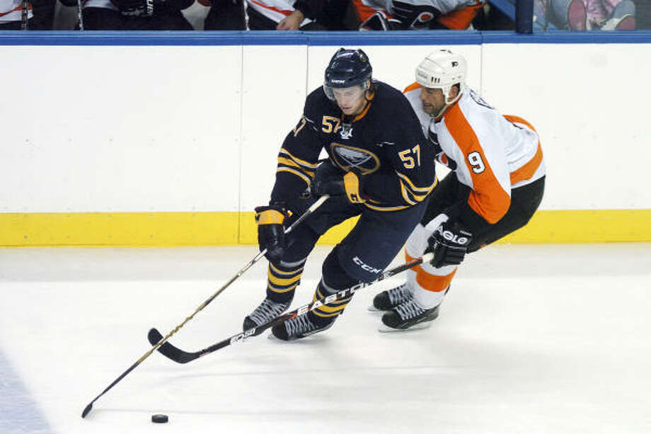 Tyler Myers, left, is an imposing force for the Sabres. Photo: Dan Cappellazzo, AP
