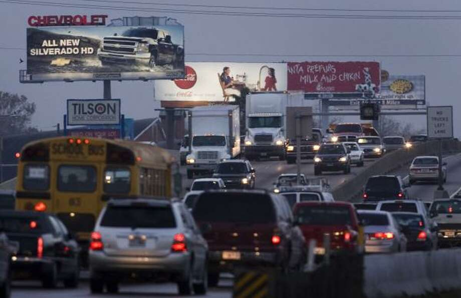 Billboards and traffic abound along Interstate 45 near Tidwell. Photo: SMILEY N. POOL, CHRONICLE