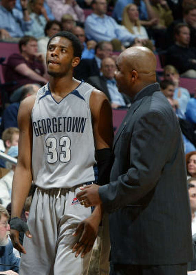 Georgetown will be led by John Thompson III, right, and Patrick Ewing Jr. will be on the floor for this game against North Carolina. Photo: Jim McIsaac, Getty Images
