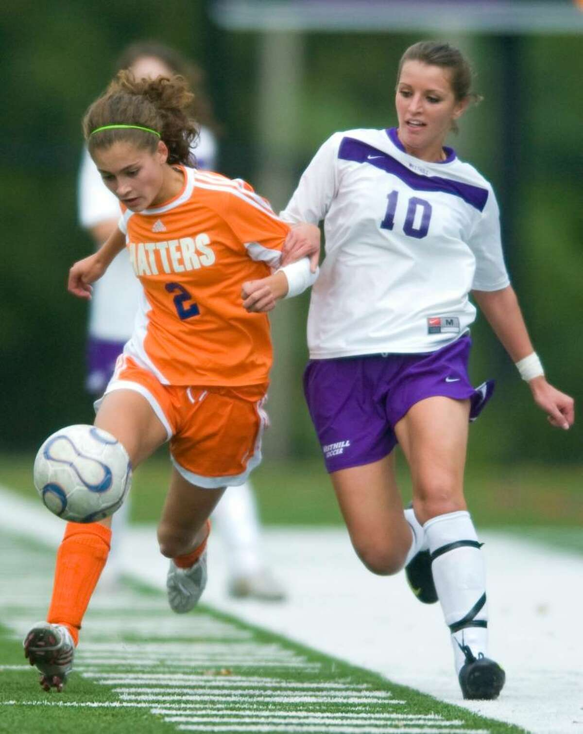 Danbury's Lexi Corte-Real, left, and Westhill's Aulona Velaj, right, during an FCIAC girls soccer match at Westhill High School in Stamford on Wednesday, Sept. 30, 2009.