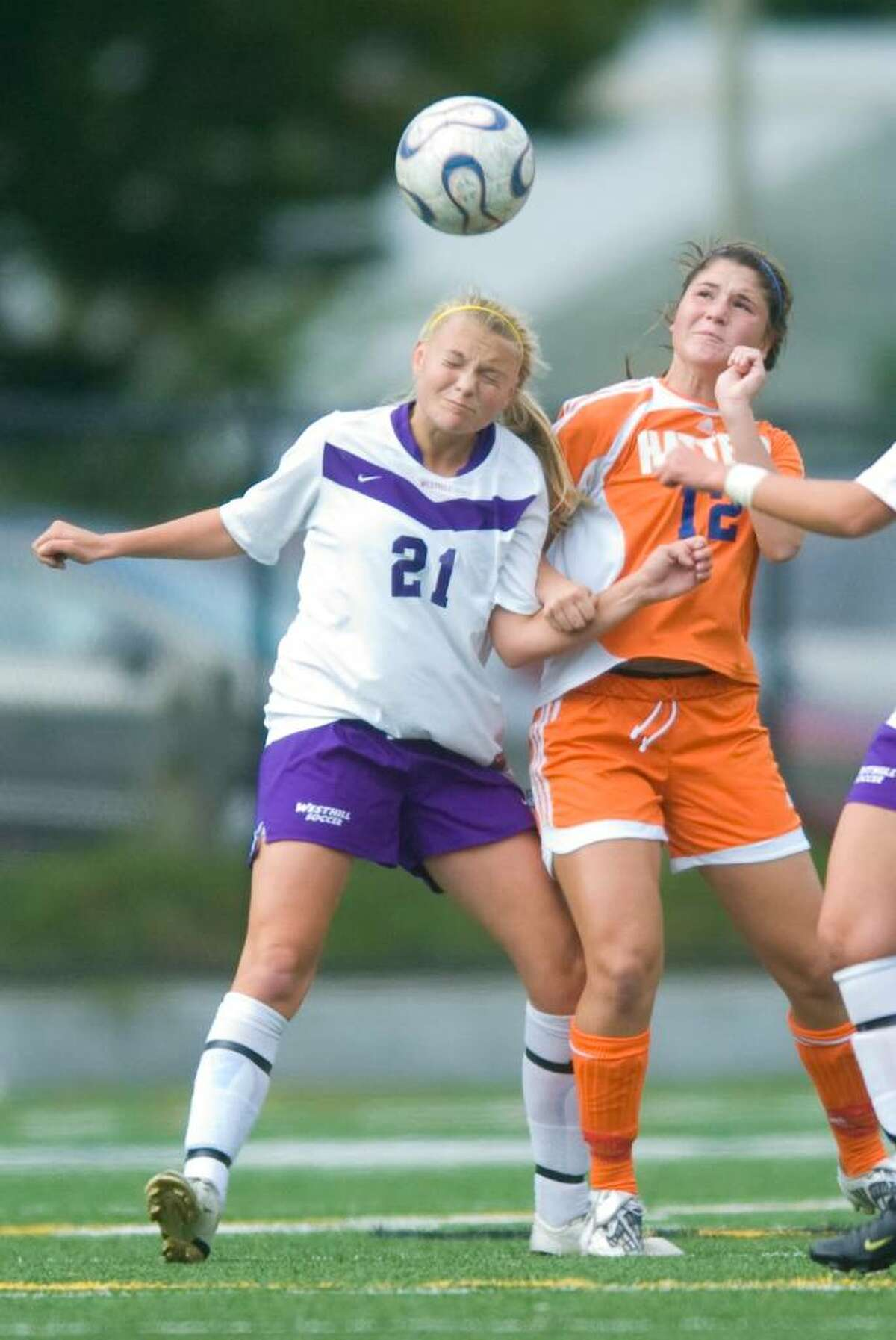 Westhill's Kirsten Eriksen, left, and Nicole Lafonte, right, during an FCIAC girls soccer match at Westhill High School in Stamford on Wednesday, Sept. 30, 2009.