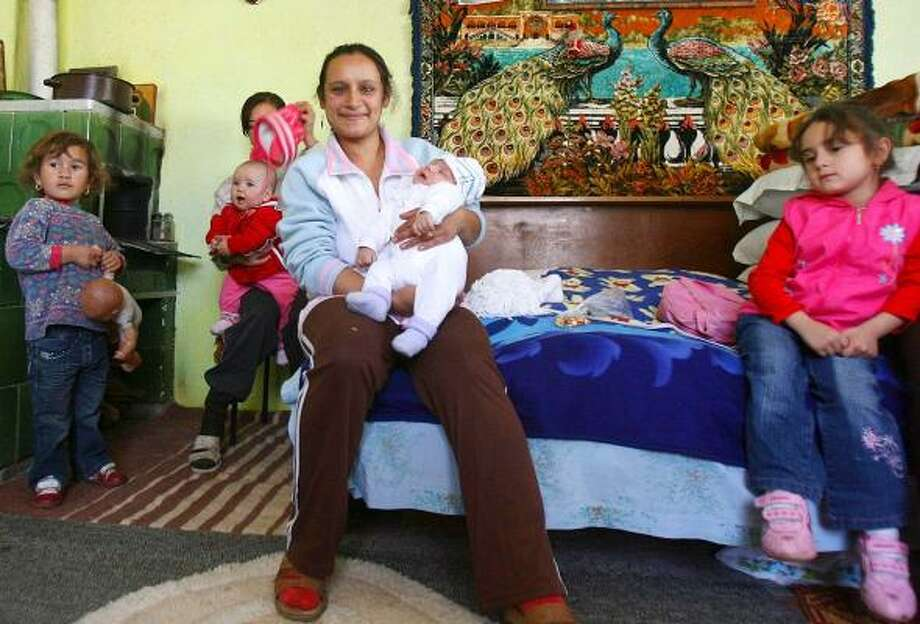 Claudia Scoica, 24, a Romanian Gypsy, holds her baby, Obama Sorin Ilie Scoica. To the country's downtrodden Gypsies, Barack Obama's election in the U.S. has provided inspiration. In Bucharest, little Obama's grandmother, Maria Savu, says she hopes the name will bring good luck. Photo: RAZVAN VALCANEANTU, EVENIMENTUL ZILEI
