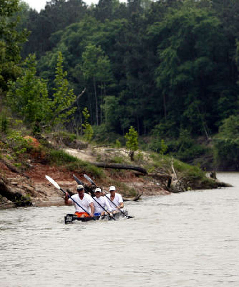 Canoe paddlers make their way up Spring Creek at Jesse H. Jones Park & Nature Center. Photo: Billy Smith II, CHRONICLE
