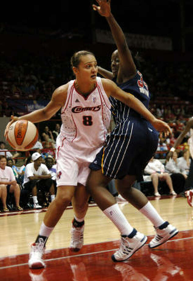 Comets forward Mistie Williams, left, drives around Indiana's Ebony Hoffman during the first half. Photo: Kirk Sides, AP
