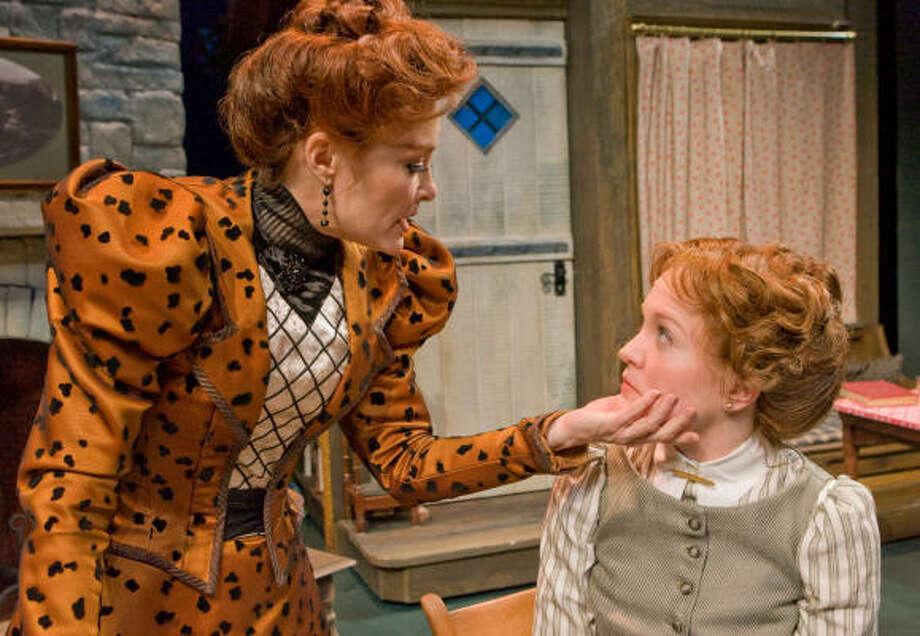 Mrs. Warren (Elizabeth Heflin, right)  tells Vivie (Jane Pfitsch) the truth in the Alley Theatre's production of Mrs. Warren's Profession. Photo: Steve Campbell, Houston Chronicle