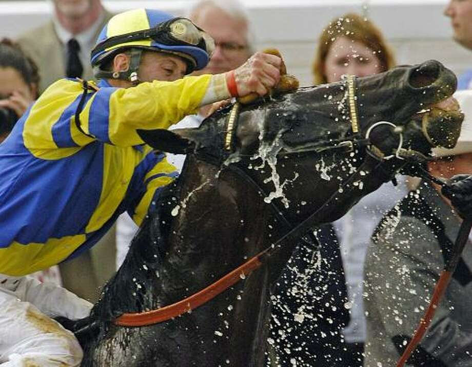 Calvin Borel helps Street Sense cool down after his charge down the stretch to victory in Saturday's Kentucky Derby. Photo: MIKE FISHER, ASSOCIATED PRESS