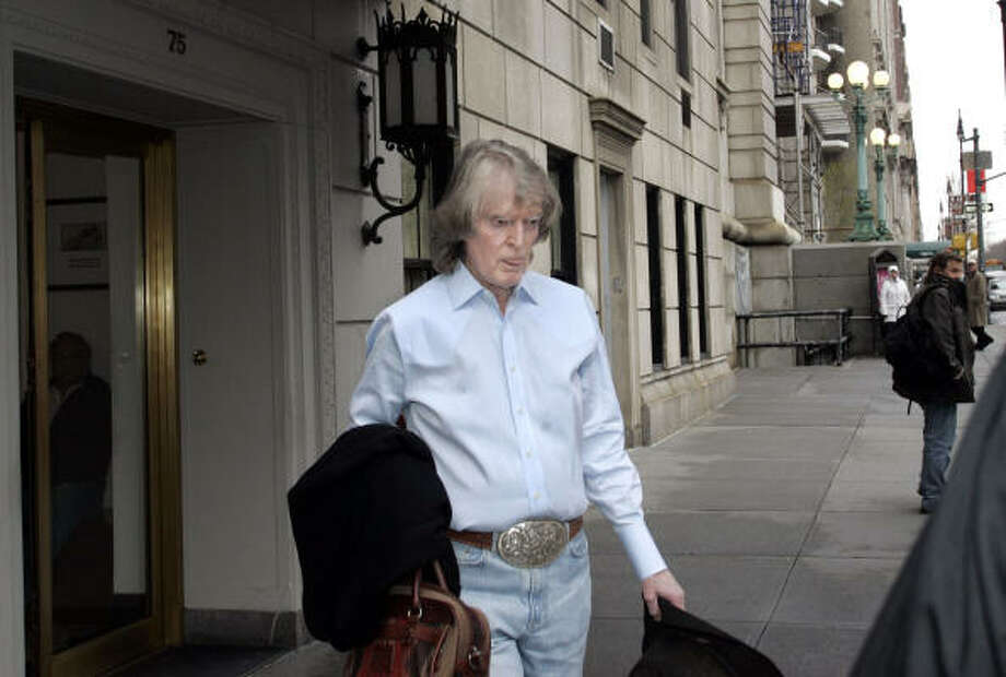 Radio host Don Imus leaves his residence in New York. On Thursday, CBS canceled Imus' program. Photo: DAVID KARP, AP