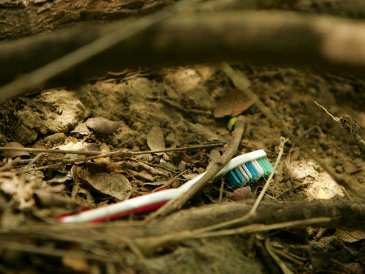 A toothbrush sits discarded on the bank of the Rio Grande inside the Santa Ana National Wildlife Refuge on May 8. Clothes and other personal items are often discarded by immigrants crossing the river.