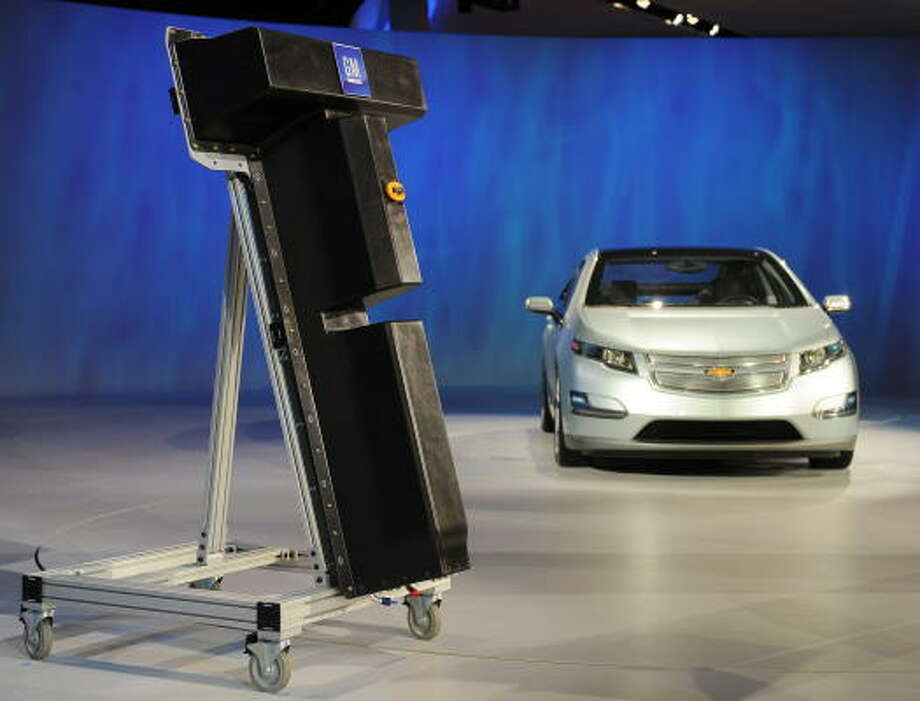 General Motors introduced its lithium-ion battery, left, that GM will manufacture for the Volt electric car in January at the North American International Auto Show. Photo: STAN HONDA, AFP/Getty Images
