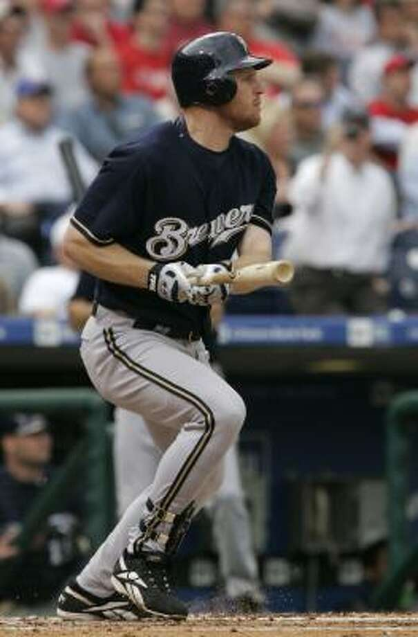 The Brewers' Gabe Gross watches the first of his two solo home runs leave the park. Photo: George Widman, AP