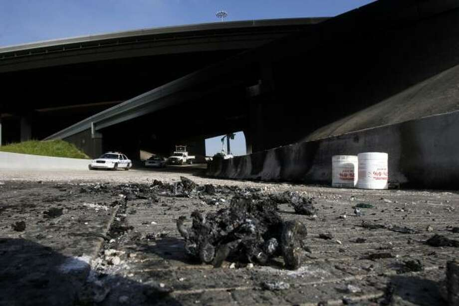Scorched debris sits near I-10 west overpass at I-59 after a  tanker truck exploded around midnight. The driver crashed on Highway 59 inbound just before the southbound ramp to I-10, Friday morning. The driver died in the accident. Photo: Johnny Hanson, For The Chronicle