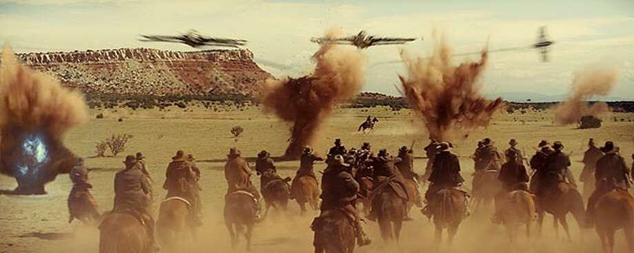 """Cowboys fight for their lives in the desert, pursued by spaceships in """"Cowboys & Aliens."""" UNIVERSAL STUDIOS"""