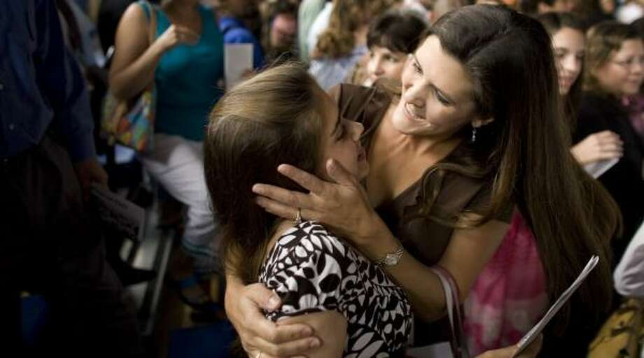 Becca Johnson, 14, is congratulated by her mother Kathryn at eighth-grade graduation ceremonies Friday at Spring Branch Middle School. She says she looks forward to the challenges at Memorial High School in the fall. Photo: SMILEY N. POOL, CHRONICLE