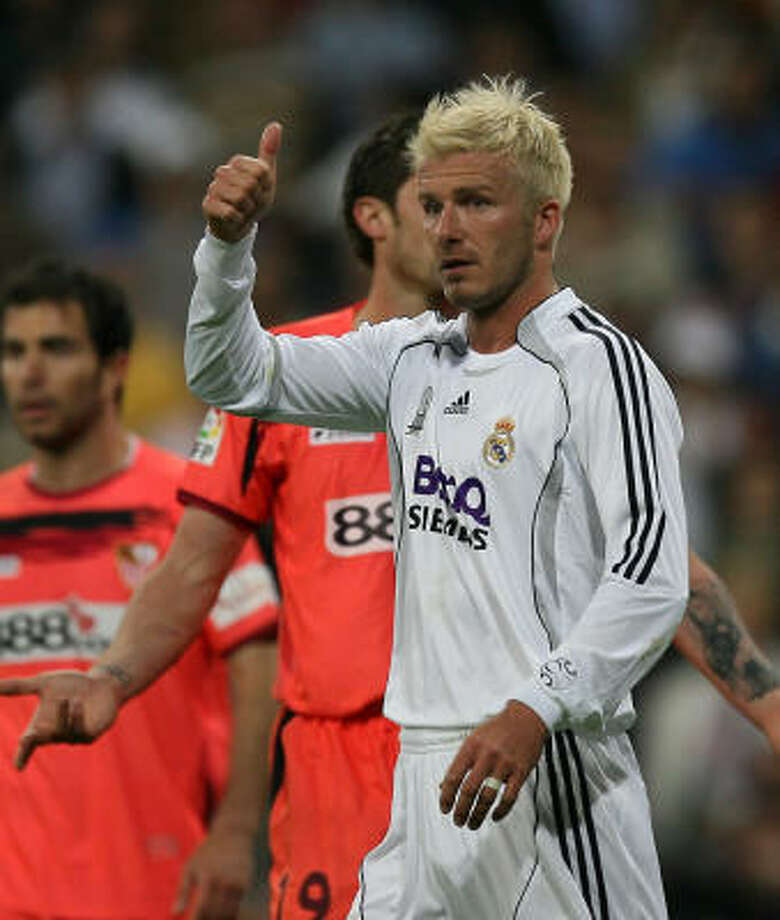 Real Madrid had help from future Los Angeles Galaxy player David Beckham in edging Sevilla 3-2 on Sunday at Bernabeu. Photo: PIERRE-PHILIPPE MARCOU, AFP/Getty Images