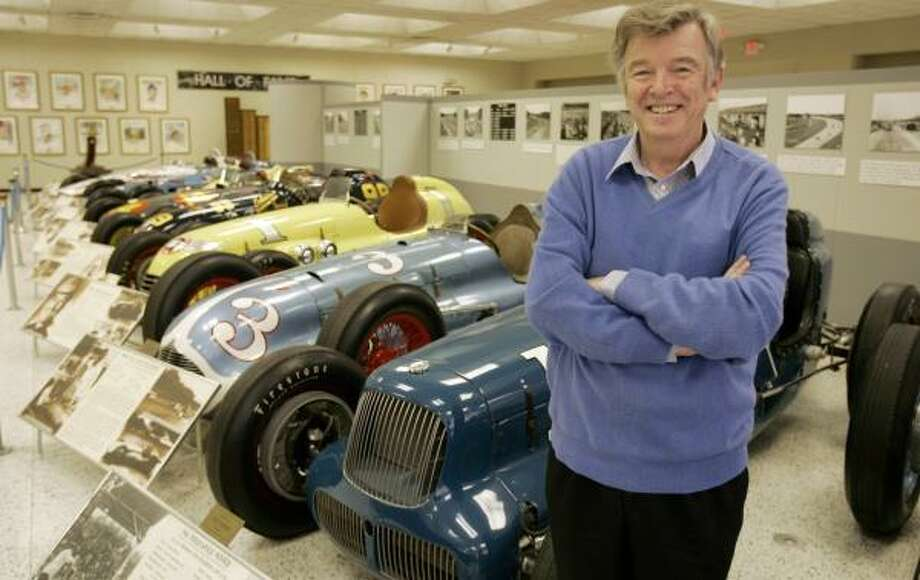 Historian Donald Davidson stands in front of some old race cars displayed at the Indianapolis Motor Speedway Hall of Fame Museum. Photo: MICHAEL CONROY, ASSOCIATED PRESS