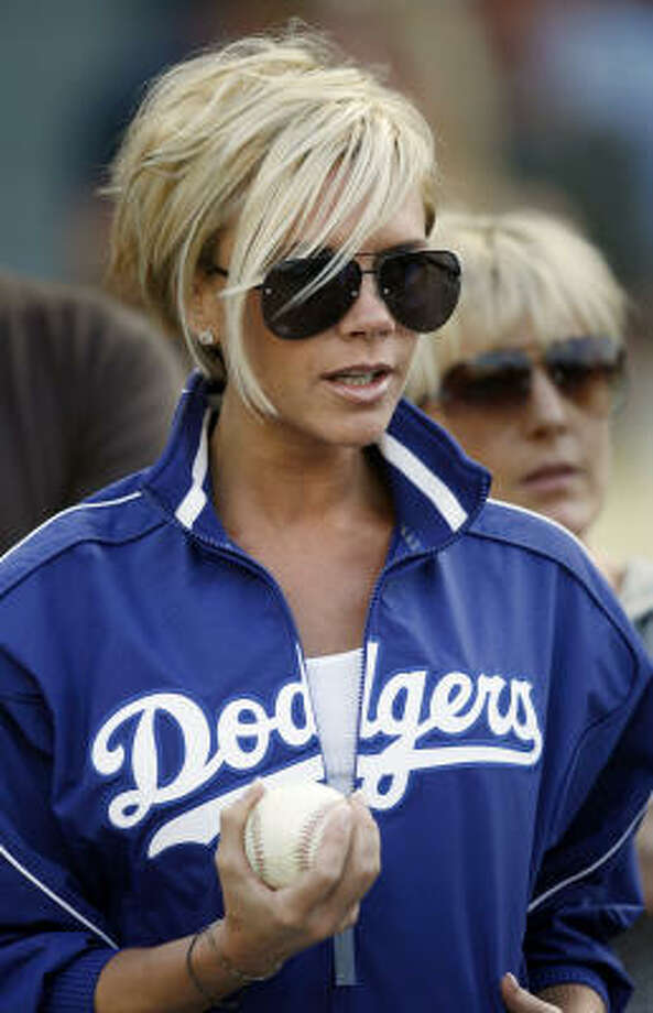 Victoria Beckham, once known as Posh Spice of the Spice Girls, added a little zest to pregame ceremonies in Los Angeles. Photo: Mark Avery, AP
