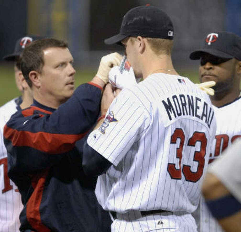 Justin Morneau had his broken nose reset and plans to play on Sunday. Photo: Tom Olmscheid, AP