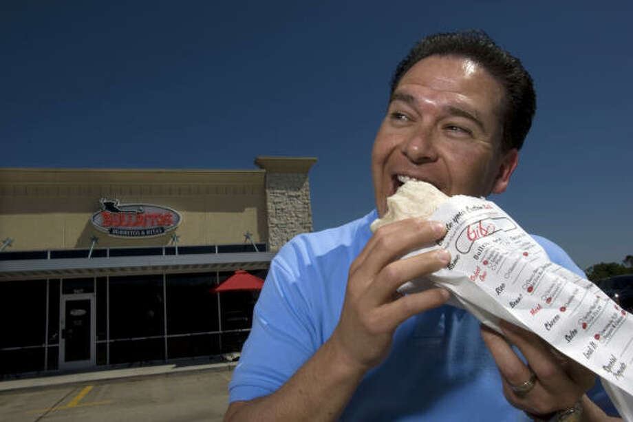 Russell Ybarra opened Bullritos in La Porte in September. Burrito chains are growing in popularity because the food is affordable and made to order, he said. Photo: Johnny Hanson, Chronicle