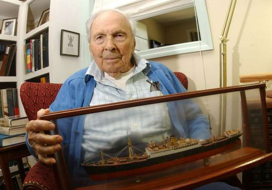 "Frank Buckles holds a scale model of the ""City of Norfolk."" He served as the ship's purser during the 1930s. Photo: RON AGNIR, ASSOCIATED PRESS"