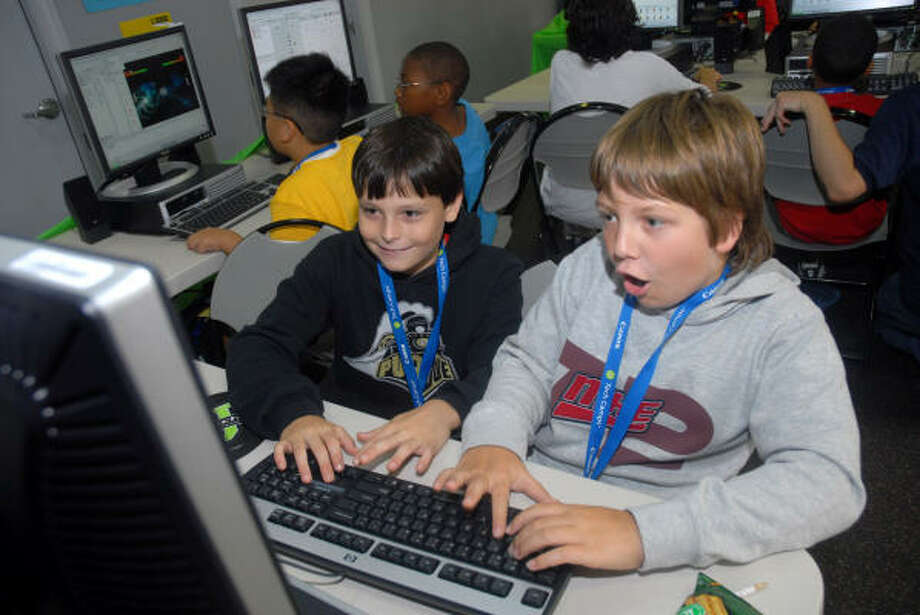 Chris Stenerson, 10, left, tries to beat Tristen Palori, 11, on a computer game they built in their summer camp's computer gaming class at the University of Houston last week. The age range for the camp is 7 to 17 years old. Photo: Megan True, Chronicle