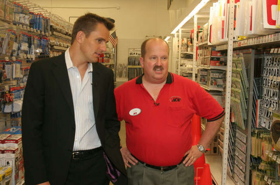 Gower Talley gets tips from Bill Rancic, season one winner of The Apprentice, while showing him around the new Ace Hardware of Gleannloch in Spring. Rancic, spokesman for the Dream Ace contest, said Talley demonstrated the ``desire and entrepreneurial spirit'' the hardware retailer had sought. Photo: Gary Fountain