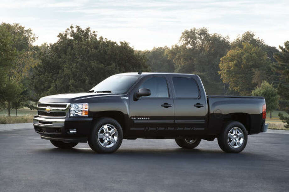 Hybrid trucks and SUVs may have higher sticker prices, by they are more fuel efficient. Photo: GM, Wieck