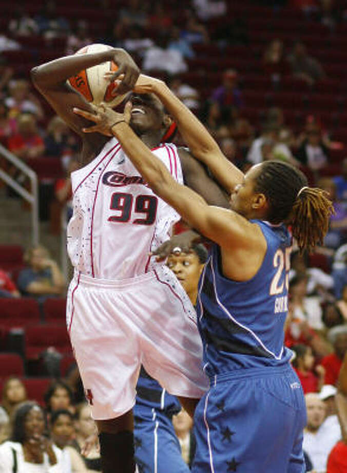The Comets' Hamchetou Maiga-Ba shows her intensity drawing a foul from the Mystics' Monique Currie in the process. Photo: Steve Ueckert, Chronicle
