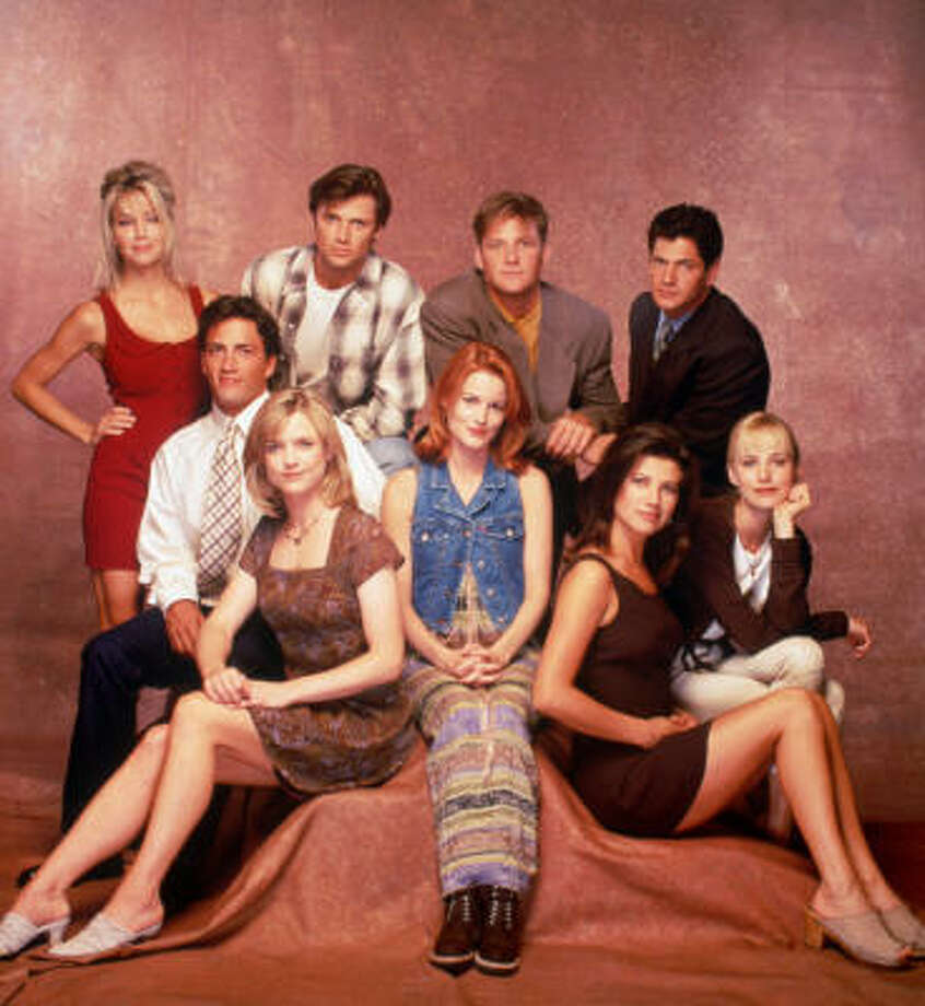 "This 1995 photo shows the cast of ""Melrose Place"": (from top left) Heather Locklear, Grant Show, Doug Savant and Thomas Calabro. (Seated from left) Andrew Shue, Courtney Thorne-Smith, Laura Leighton, Daphne Zuniga and Josie Bissett. Photo: Associated Press"