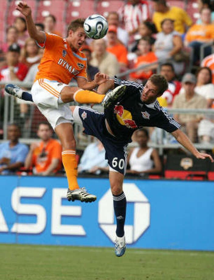 The Dynamo's Stuart Holden and the Red Bulls' Jeff Parke battled for the ball. It was one of few fights the Red Bulls put up all night. Photo: Billy Smith II, Chronicle