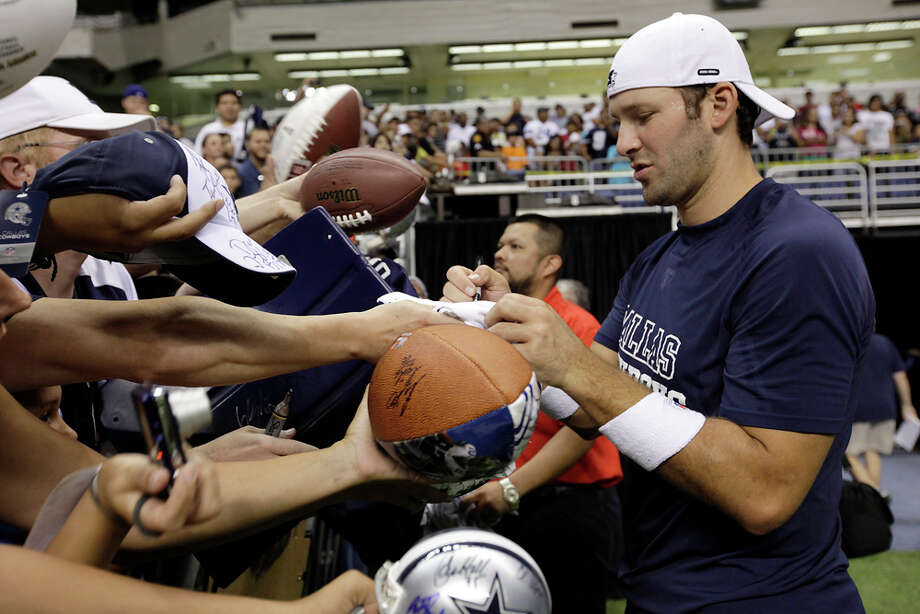 QB Tony Romo and the rest of the Cowboys return to the Alamodome for the kick-off of training camp. JERRY LARA / EXPRESS-NEWS