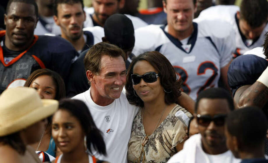Broncos head coach Mike Shanahan hugs the mother of the late Darrent Williams after Thursday's practice. Photo: Tom Pennington, AP