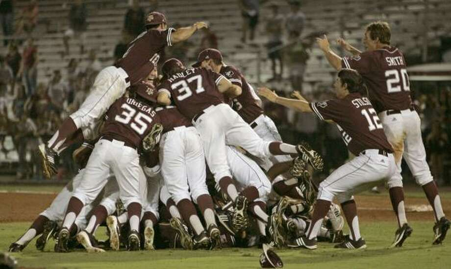 Tallahassee Super Regional Game 3: Texas A&M 11, Florida State 2 (A&M wins series 2-1) A&M players form a dogpile as they celebrate the victory. Photo: Steve Cannon, Associated Press