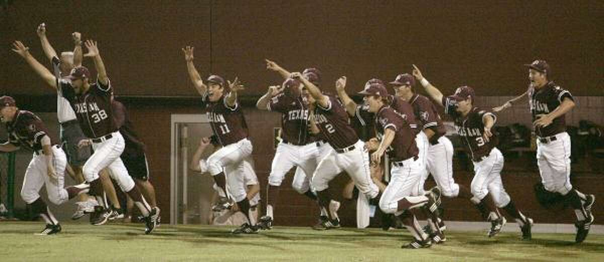 A&M players rush onto the field after beating FSU.