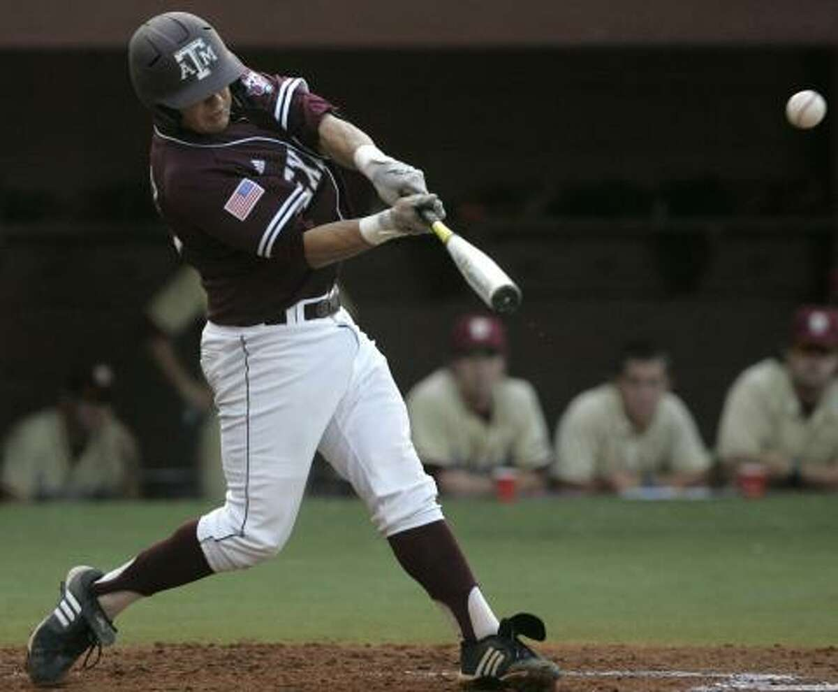 A&M's Kevin Gonzalez swings for a two-run double in the first inning.