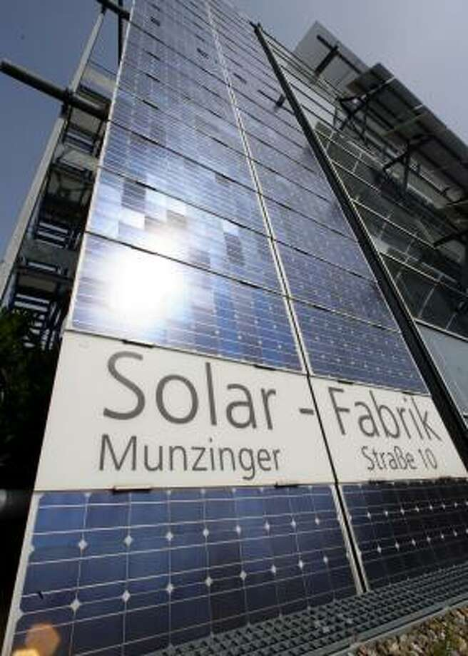Sun reflects off the entrance of the Solar-Fabrik, or solar factory, in Freiburg, Germany. The company has grown from a solar panel maker to an international, stock market-listed solar power group. Photo: WINFRIED ROTHERMEL, ASSOCIATED PRESS